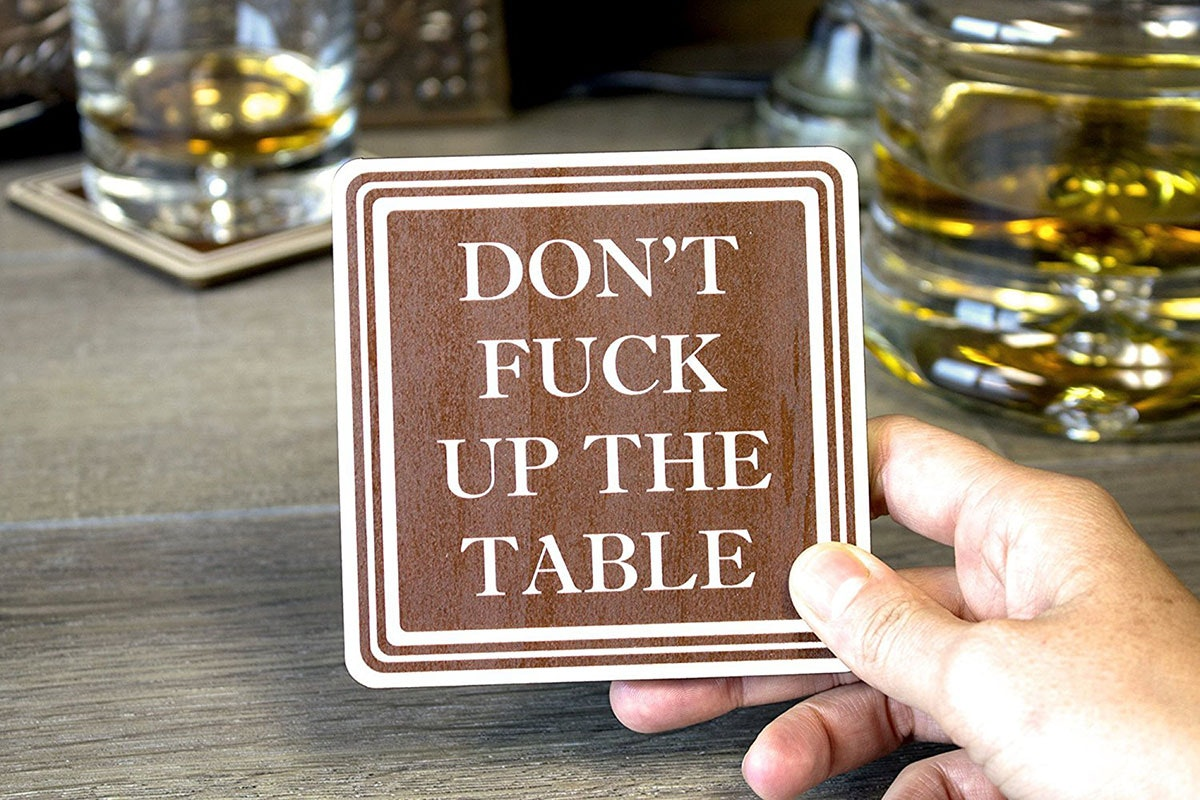 Keep hilarious coasters on hand to keep your guests in line (and your furniture looking mint)