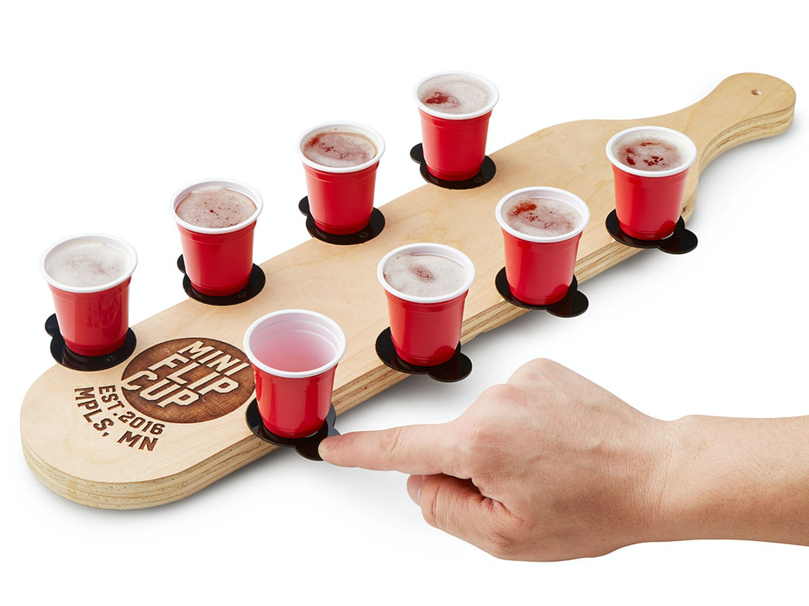 A miniature travel edition of flip cup