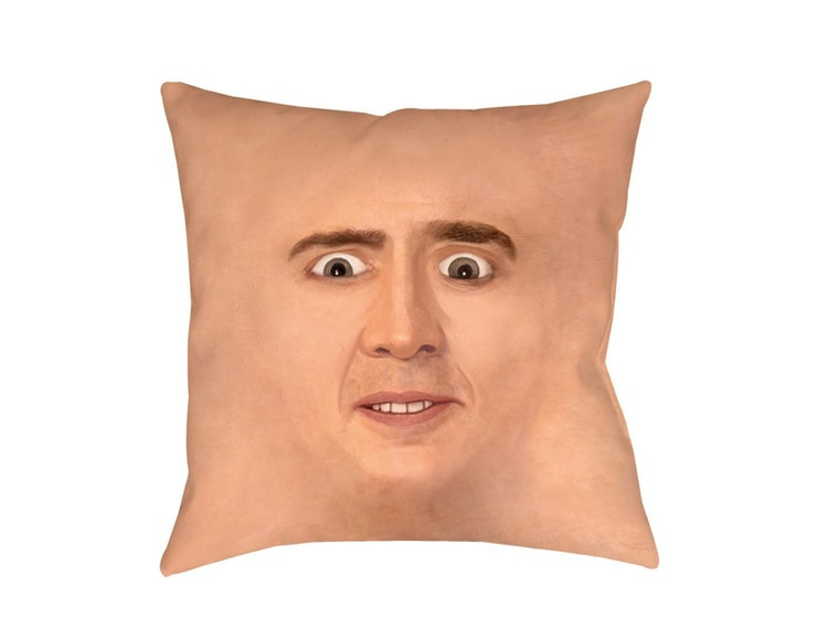 This pillow that's just Nic Cage's face