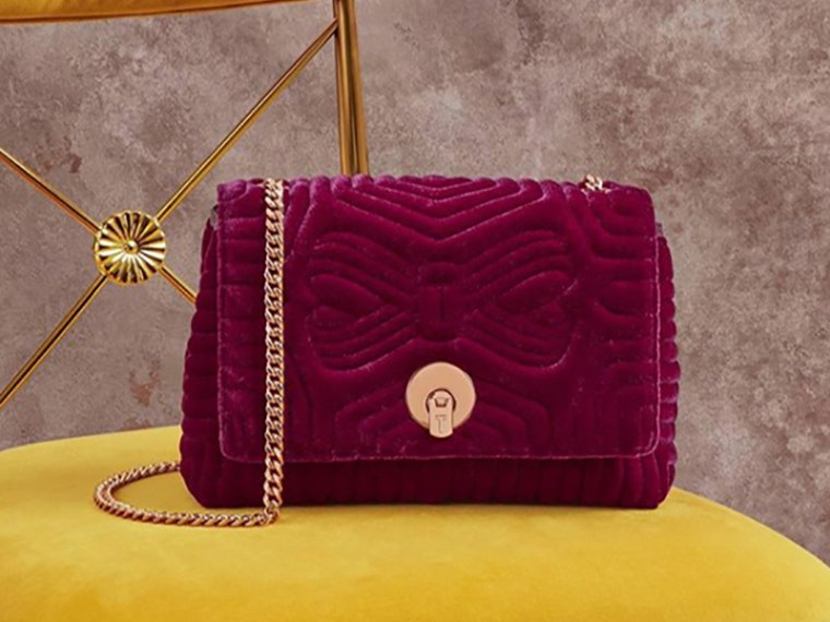 The sweetest raspberry Ted Baker purse we could find