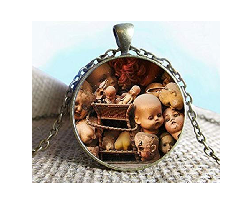 This haunting necklace with a ton of dismembered doll heads on it