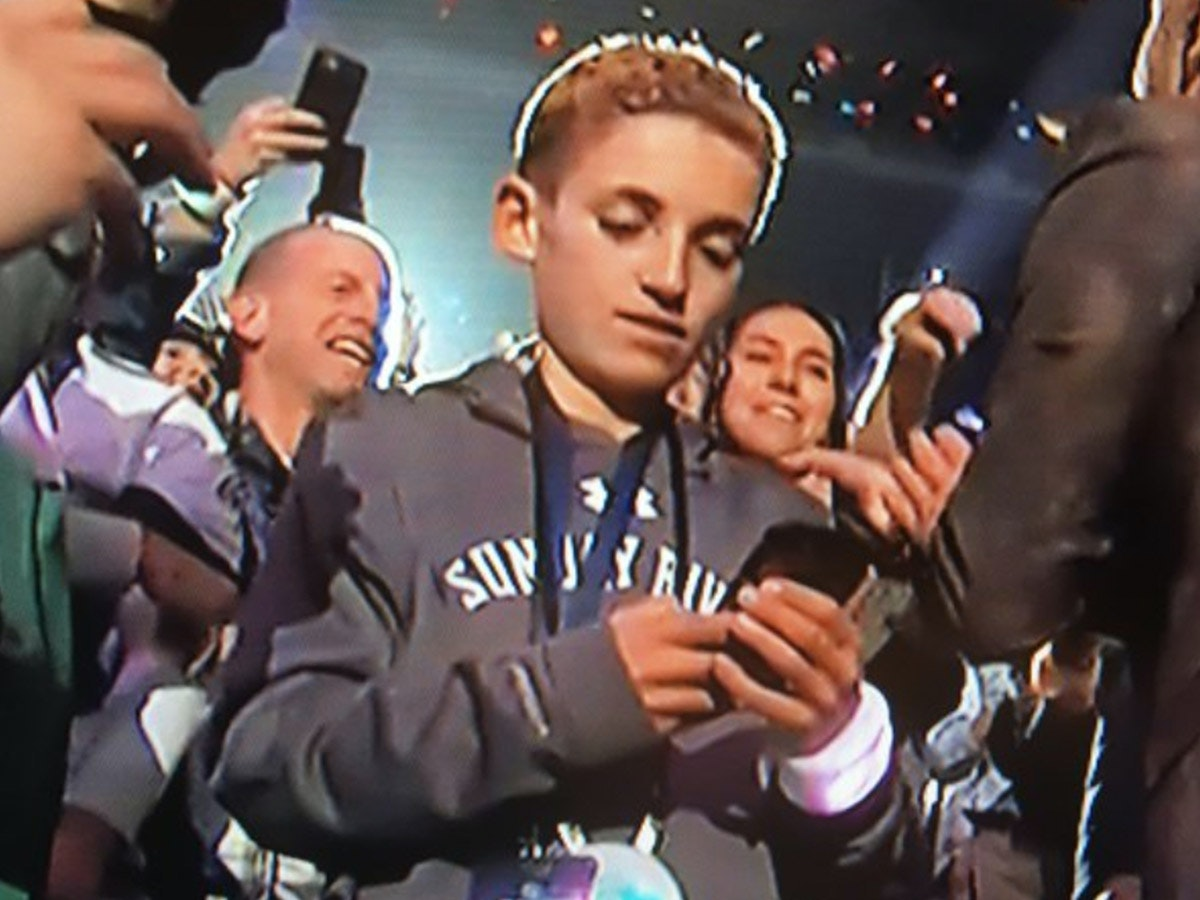 Everything Halftime Kid Was Doing on His Phone at the Super Bowl