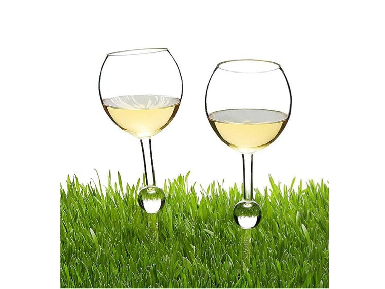 These spiked wine glasses that wedge in the grass 🍷