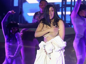 Cardi B Performs in a Bathrobe After a Wardrobe Malfunction at Bonnaroo Music and Arts Festival