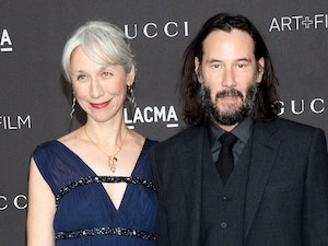 Keanu Reeves Holds Hands With Human on Red Carpet; World Loses Collective Mind
